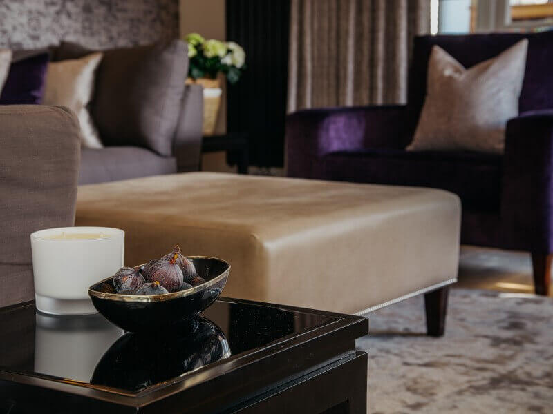 Contemporary luxe living room in Harrogate with bespoke purple velvet armchair