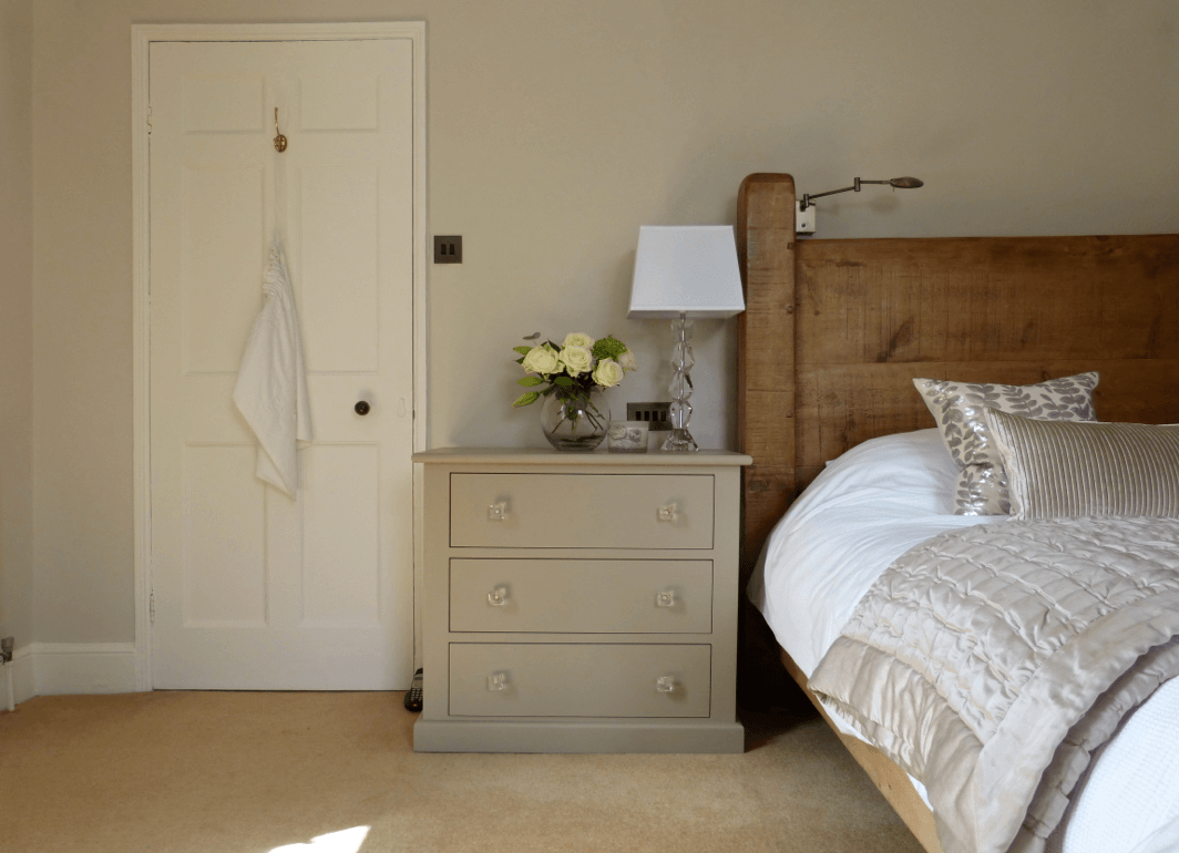 Contemporary luxe bedroom with small chest painted in Little Greene Rolling Fog Dark
