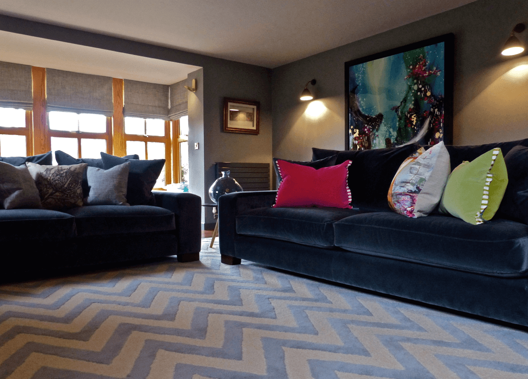 Contemporary grey sitting room with chevron rug