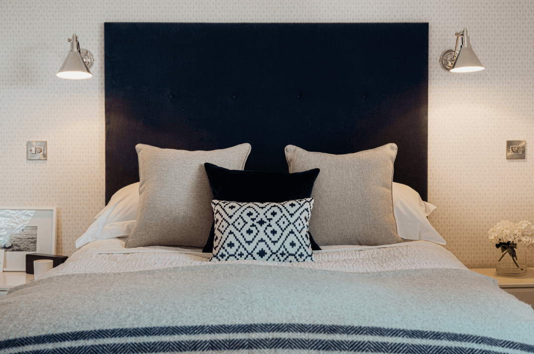 Bespoke contemporary oversized headboard in navy blue linen
