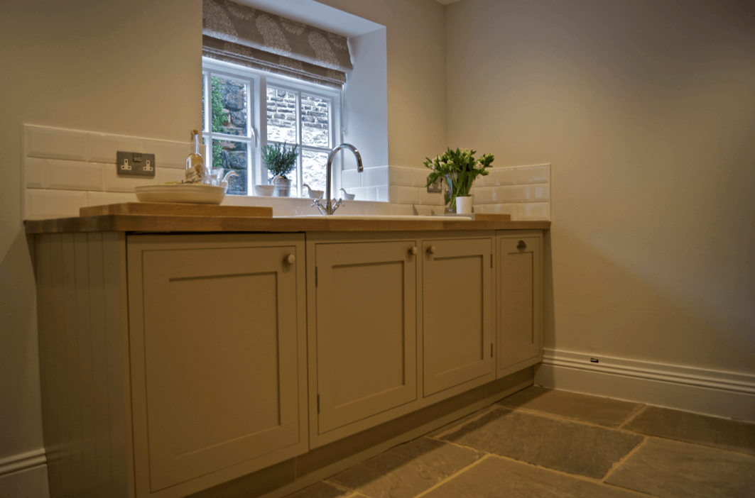 Country kitchen with Roman blind in paisley fabric by Titley & Marr
