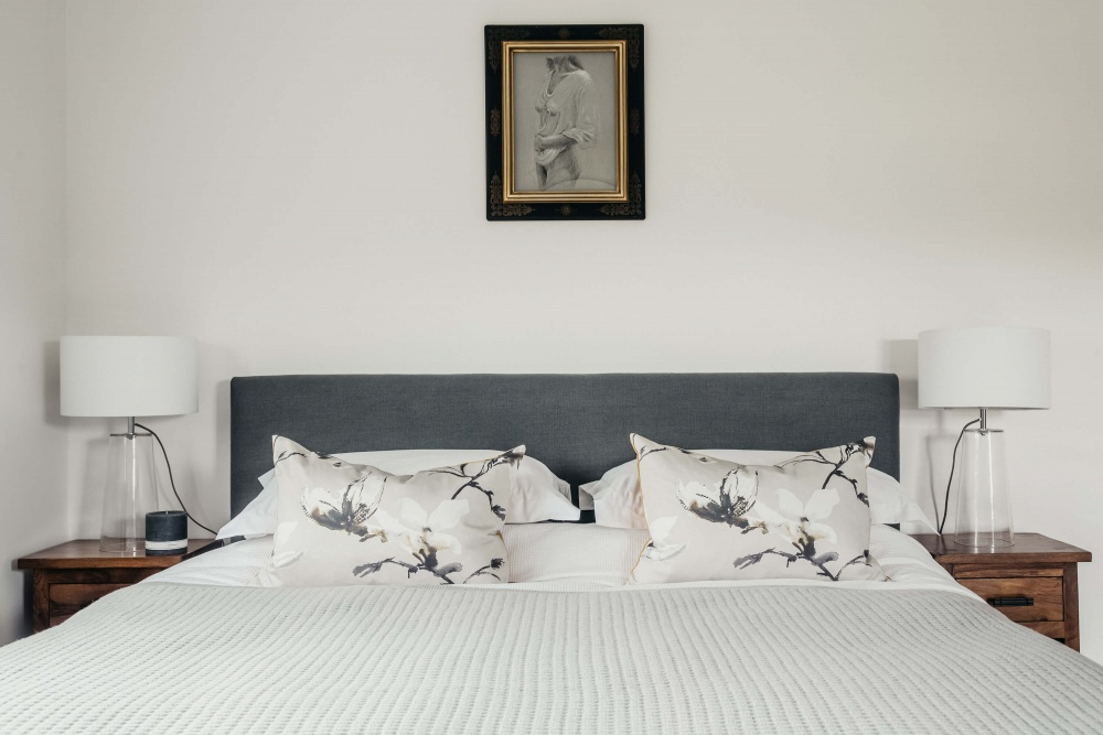 Contemporary bedroom with grey White Company blanket