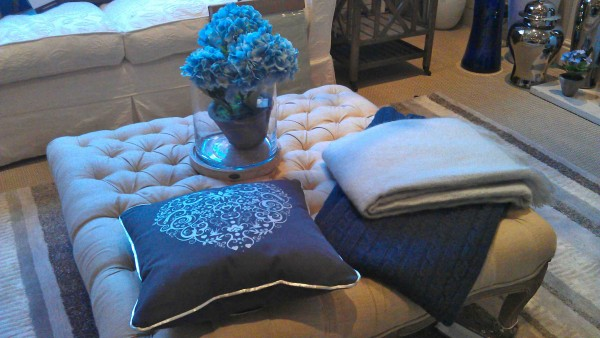 Large ottoman, cushions and throws (and ginger jar in background), from James Brindley