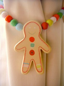 Neutral nursery with lovely details (ginger bread man curtain tie-back)