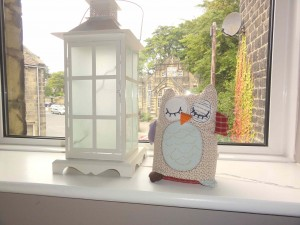 Warm, neutral nursery with lantern and owl detail