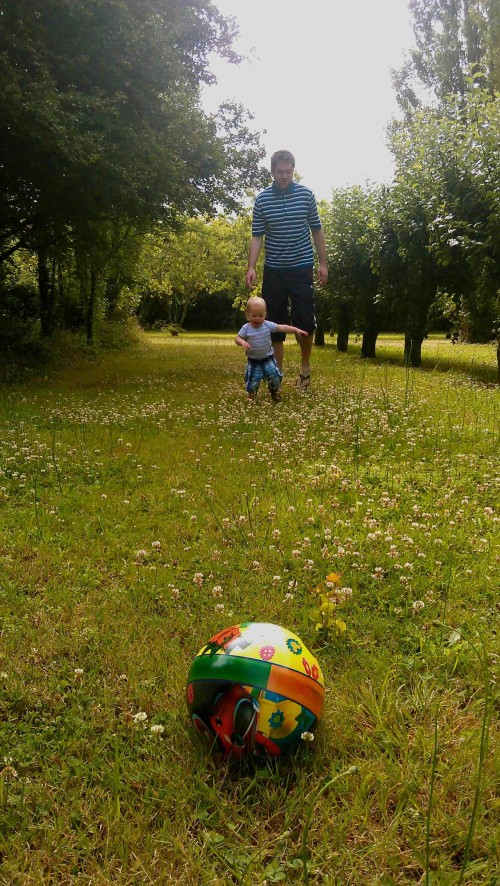 The Small One and The Tall One playing football in the orchard
