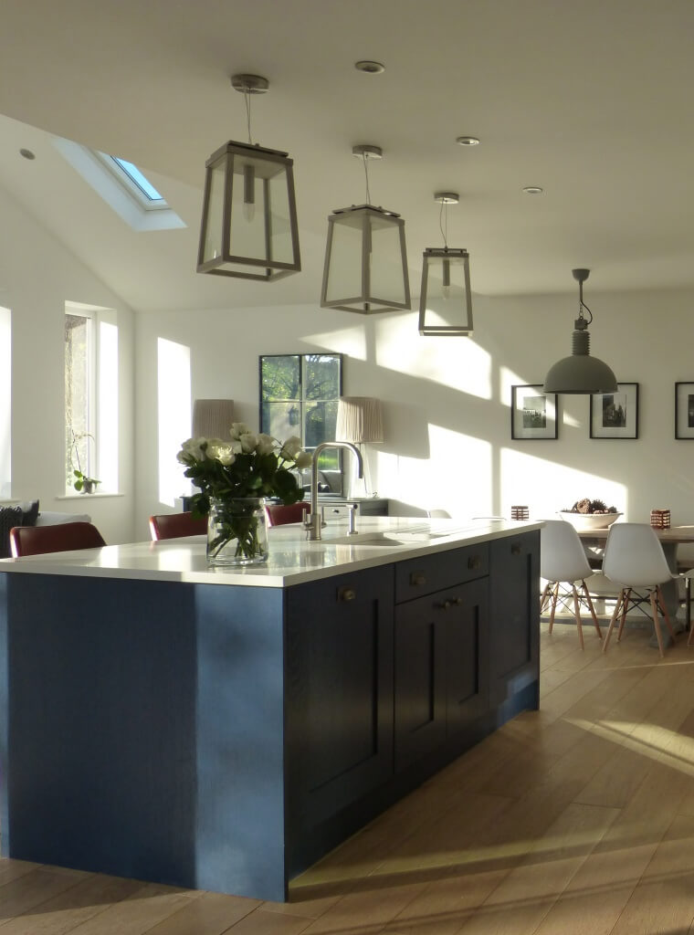 Blue & White contemporary country kitchen with vintage leather bar stools, oversize pendant lights