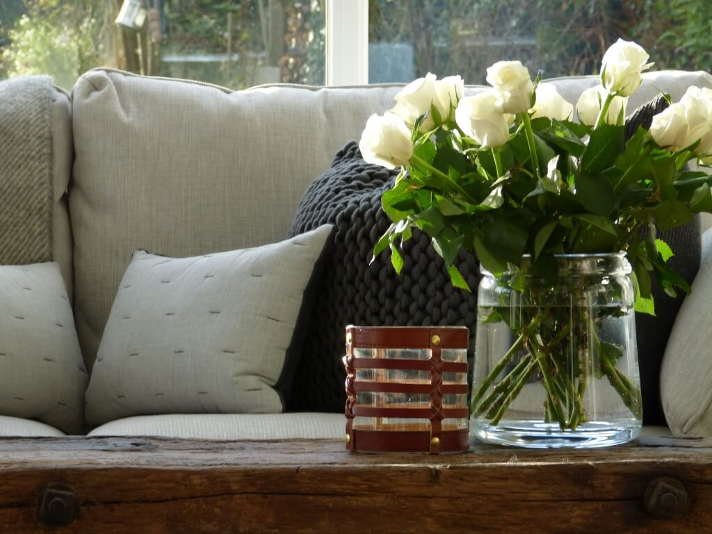 Antique pig bench with recycled glass vase, and The White Company Cushions