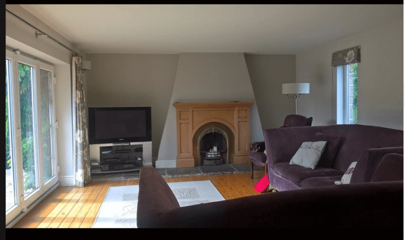 The sitting room before, with Cottage style chimney