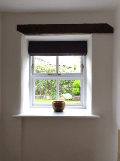 Simple window in a converted barn